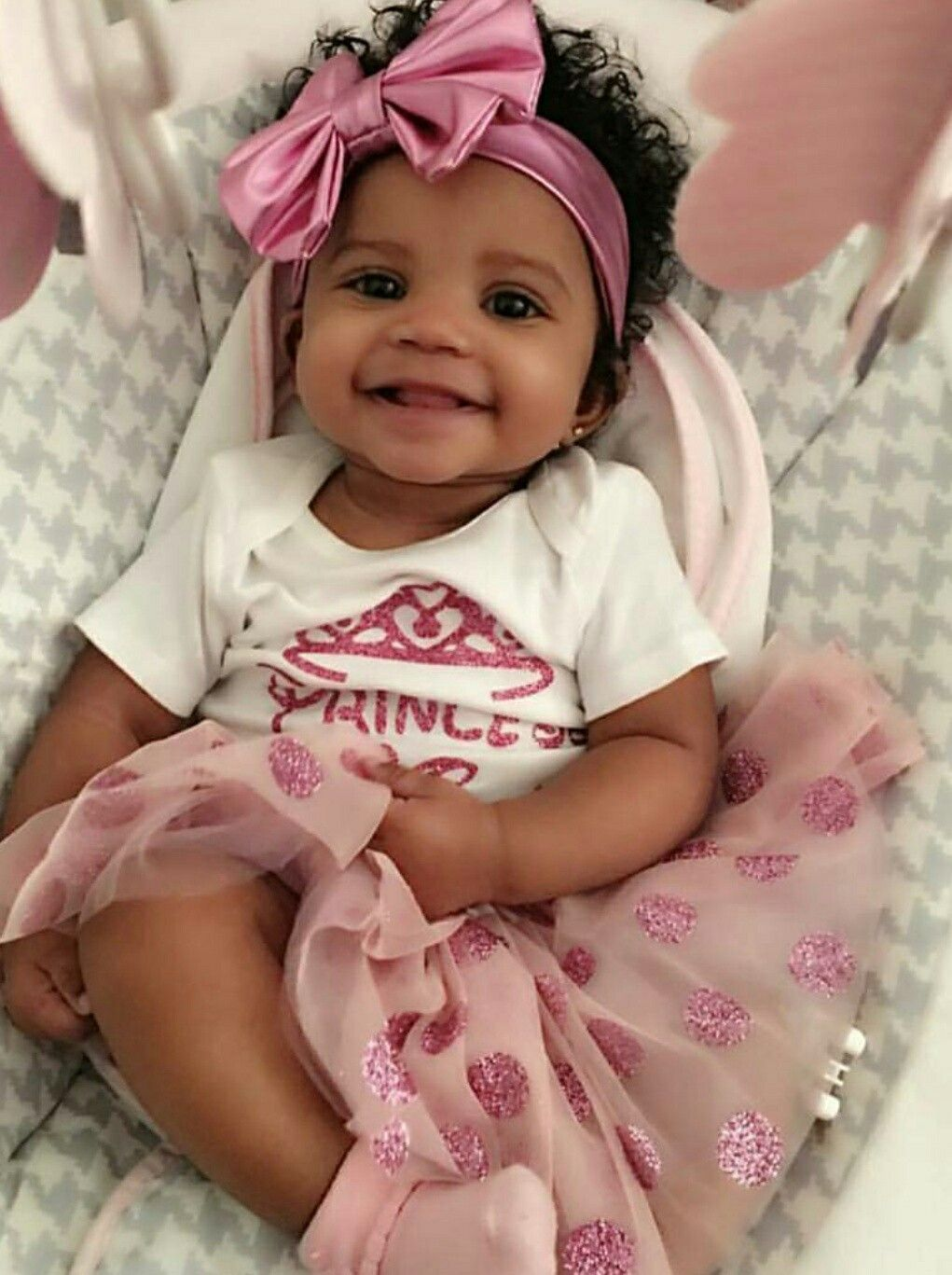 adorable baby girl wearing pink bow. princess t-shirt, tulle skirt