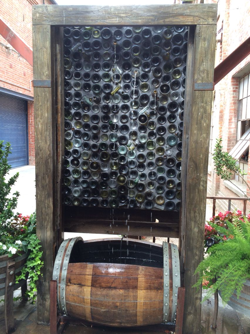 Wine bottle water feature fabulous fountains pinterest for Outdoor feature wall ideas