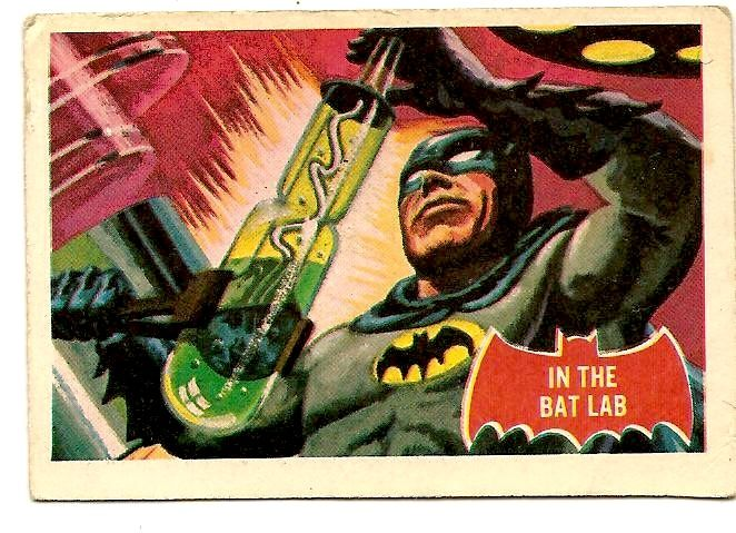 Topps Batman card, art by Norman Saunders: In the Bat Lab. Interesting perspective, you see how Saunders views how Batman's cowl and cape connect (or don't).