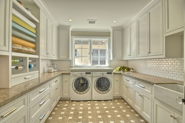 Can you imagine having a laundry room like this?? Check out the gift wrapping station!