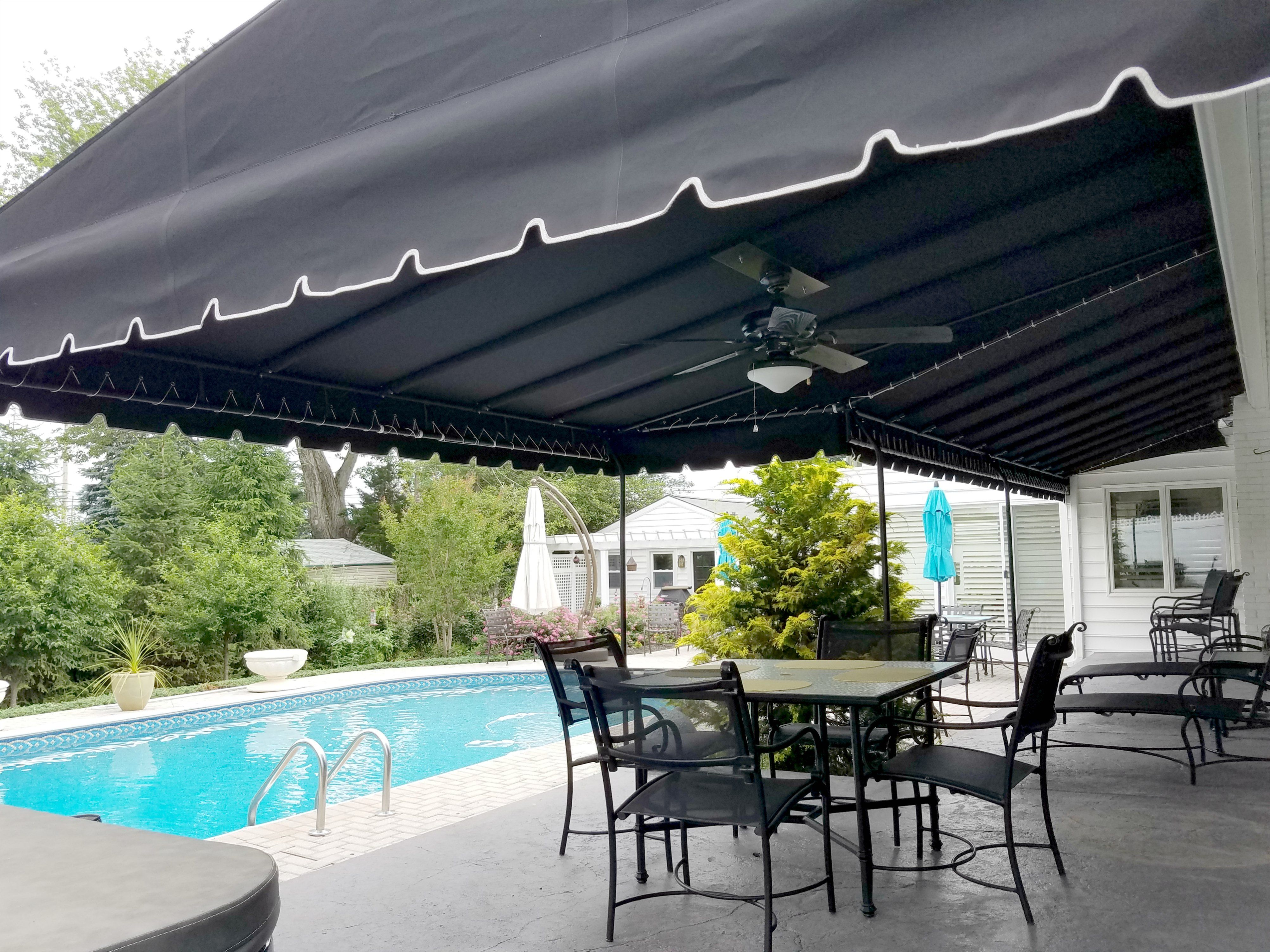 Shade Is A Welcome Friend By A Pool A Black Powder Coated With Matching Sunbrella Fabric An Ceiling Fan Kit Patio Awning New Homes Fabric Awning