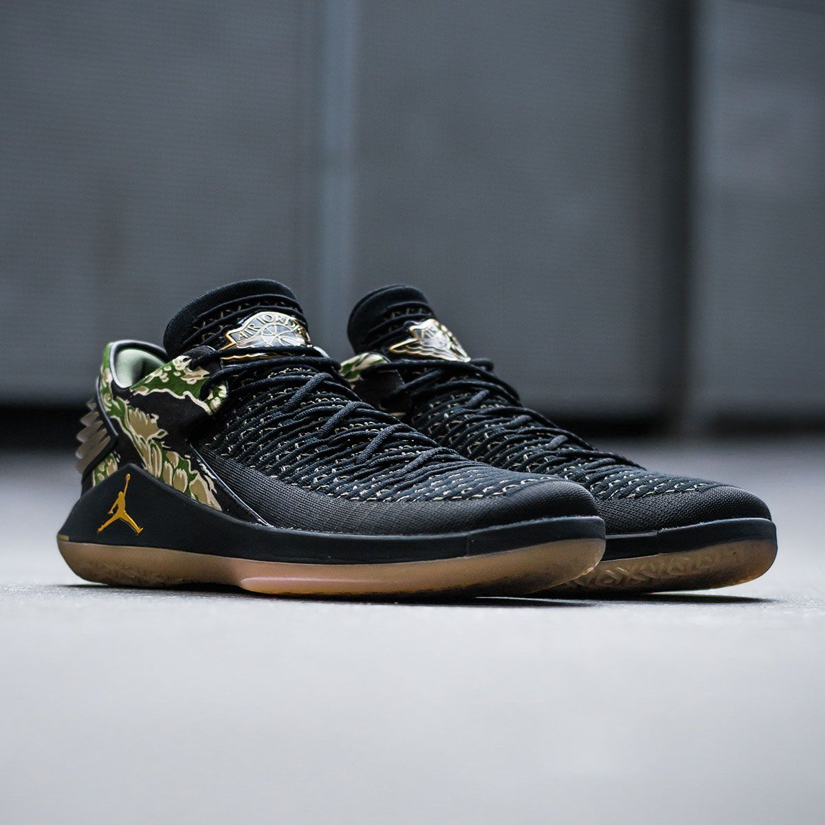a4819987e8b9d0 These black Air Jordan XXXII Low with tiger camo around the heel and golden  accents are available now on KICKZ.com and in selected stores!