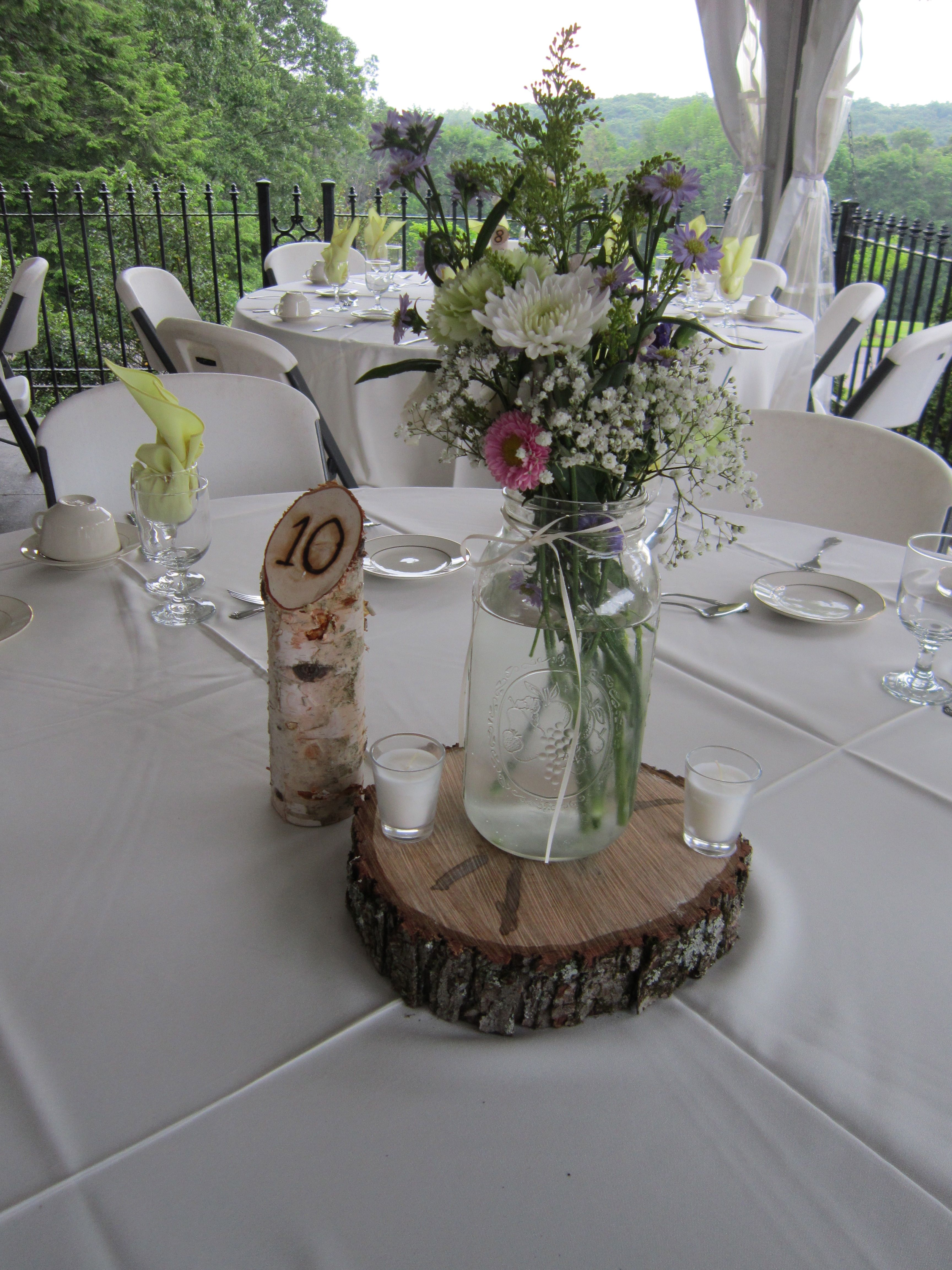 Mason Jar With Fresh Flowers On A Wooden Cookie With A Birch Branch Table Number Wickham Wedding Themes Rustic Rustic Country Wedding Mason Jar Decorations