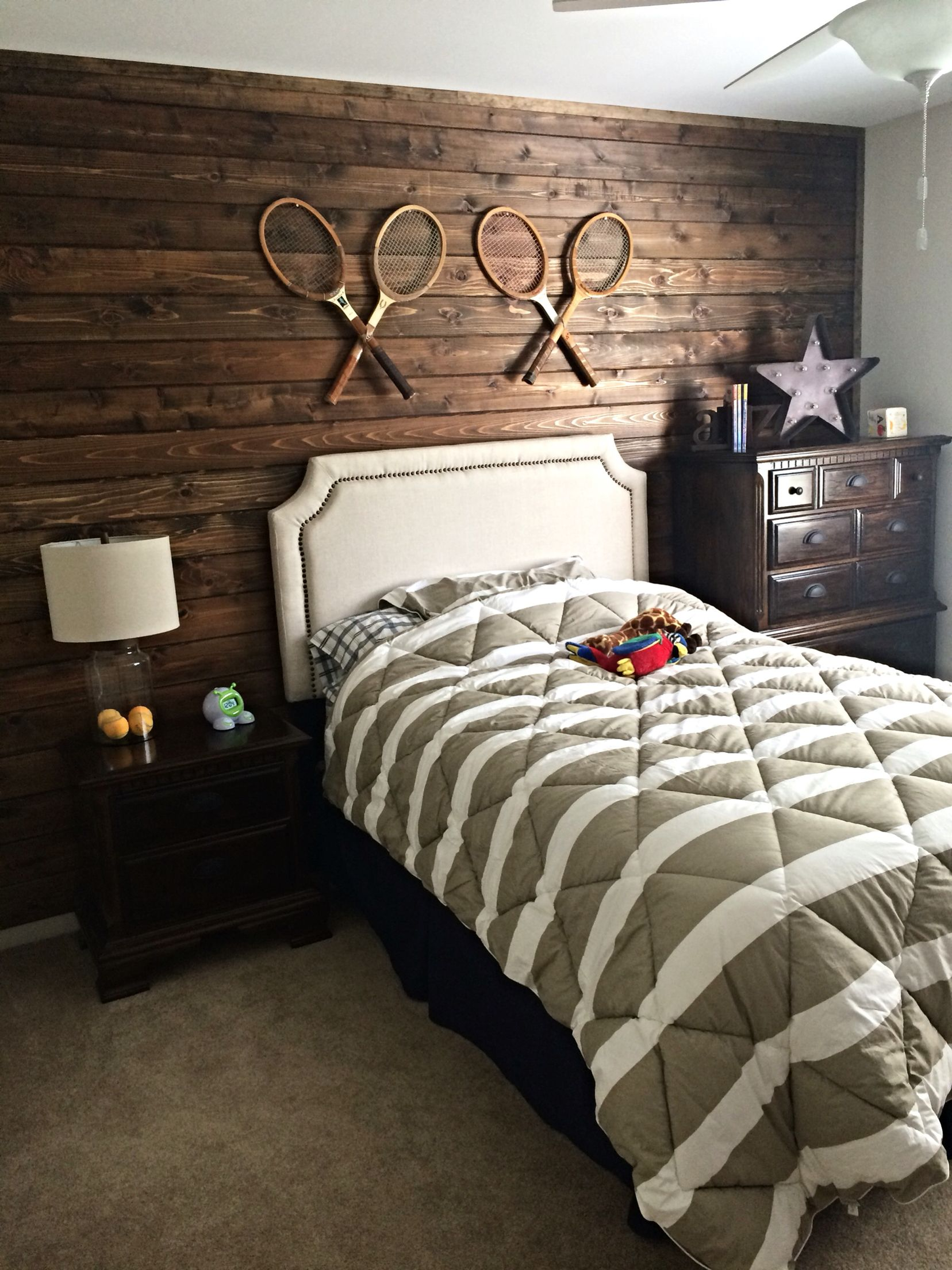 . Wood plank wall  antique tennis racquets    tennis themed room