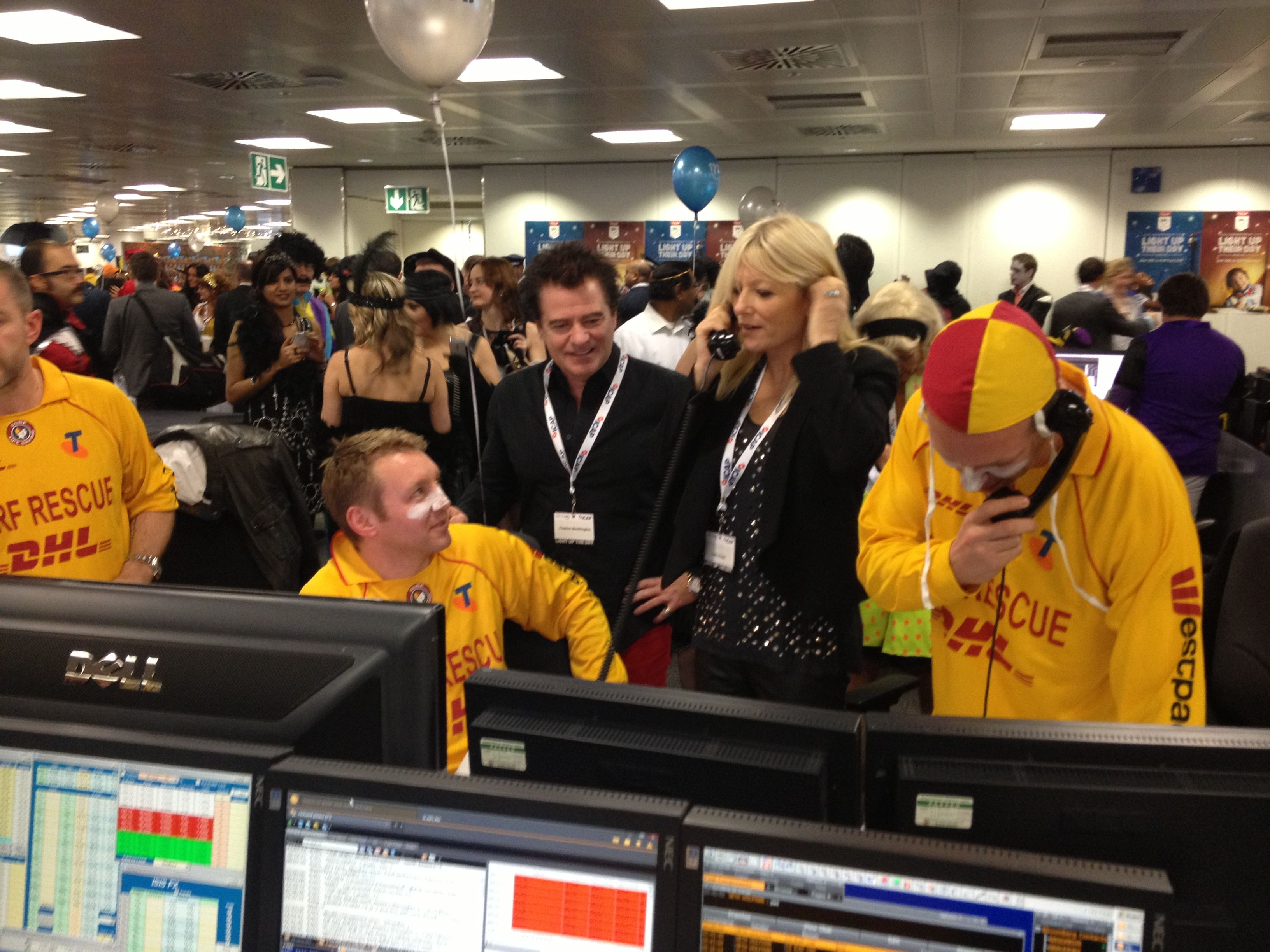Gaby Roslin closing a deal with the life guards #icapcharityday #lgfbuk