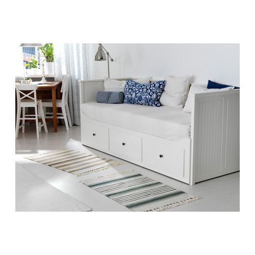 Ikea daybed that pulls out into a bed that sleeps two people! LOVE this!