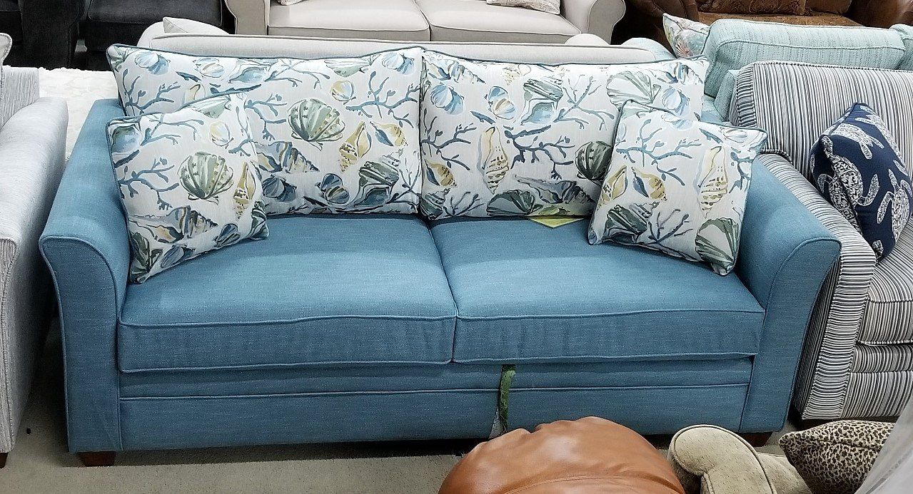 This Is A Really Cute Sleeper Sofa I Love The Sea Blue Color Of The Main Upholstery The Four Pillow Sitt Consignment Furniture Upholstery Furniture Warehouse
