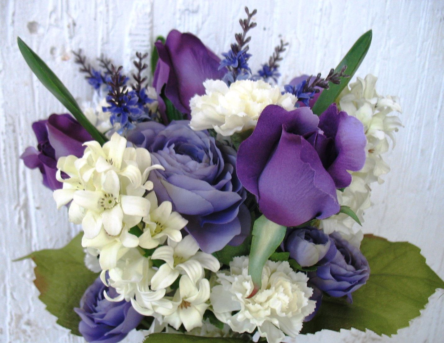 Purple roses and ranunculus with white hyacinths