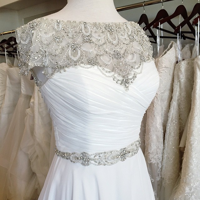 ec931f5762e Justin Alexander 8799 has never looked this sparkly! The art deco beaded  neckline will make any bride shine on her wedding day.