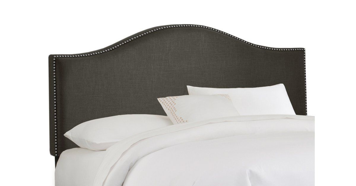 Gently undulating lines add a sophisticated appeal to this arched upholstered headboard. Features gleaming pewter nail-head trim. Attaches to any standard bed frame. Handcrafted in the USA.
