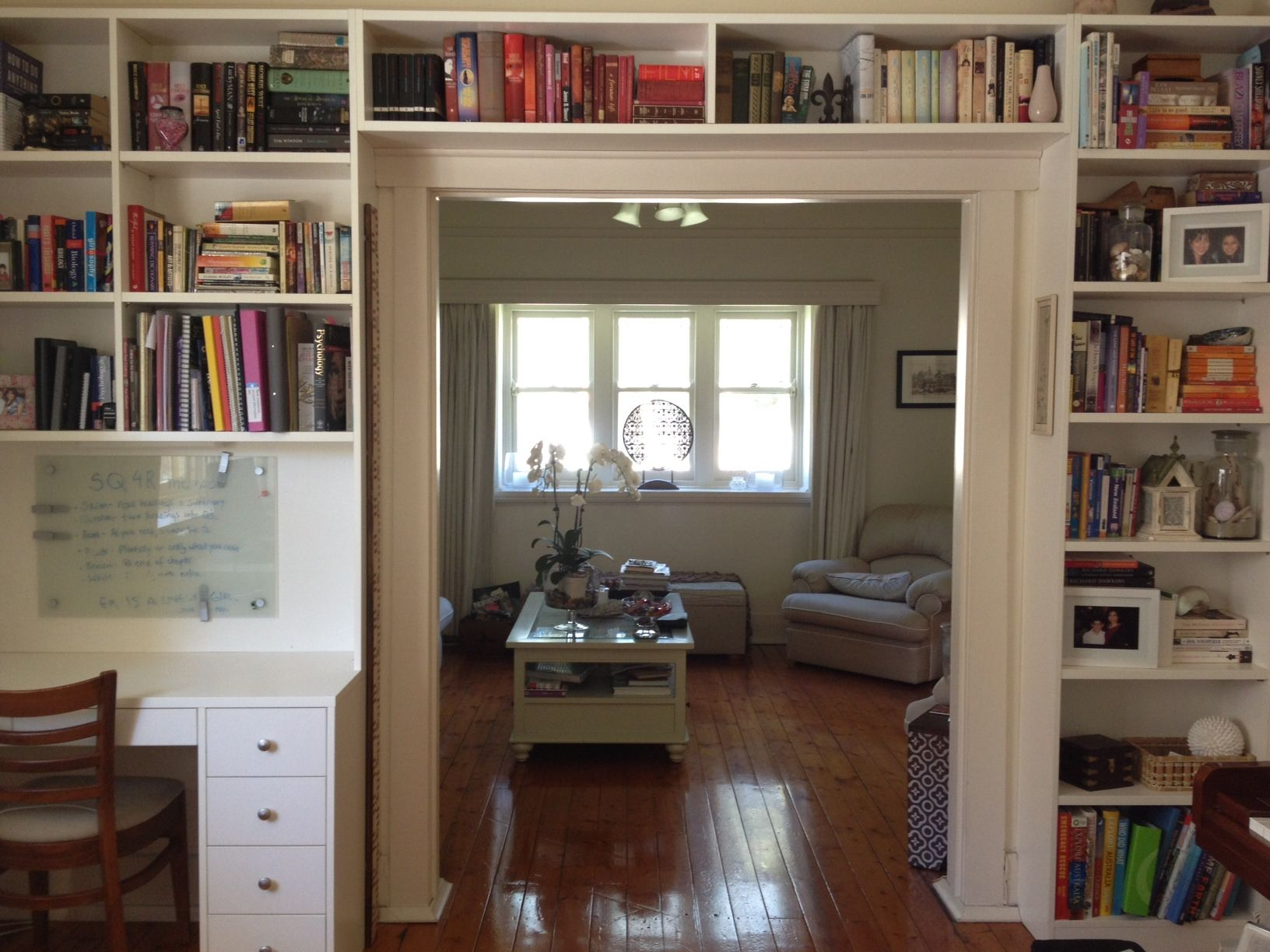 Built In Bookshelves Around A Door Frame