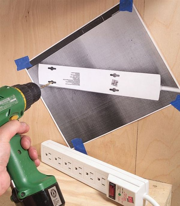 Photocopy the back of whatever you want to hang.  Tape to the wall for perfect alignment before drilling holes.