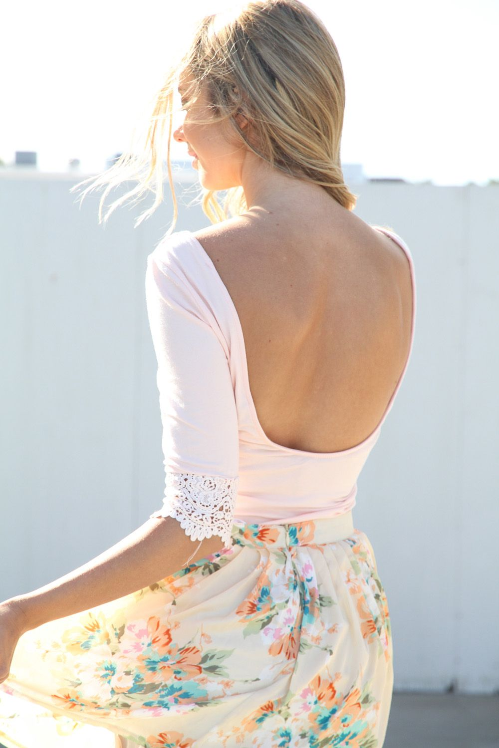 Sabo Skirt Jasmine Top. Adorable blush pink top featuring a low back and lace trim detailing on the sleeves. Crop sleeves, stretch fabric. Looks super cute tucked into high waisted cut offs and ankle boots.