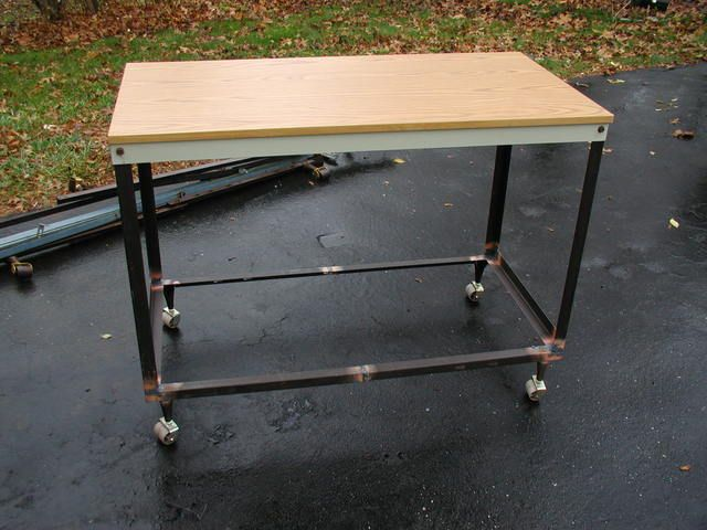 Guy made workbench from old bed frames. Welded bed fram angle iron ...