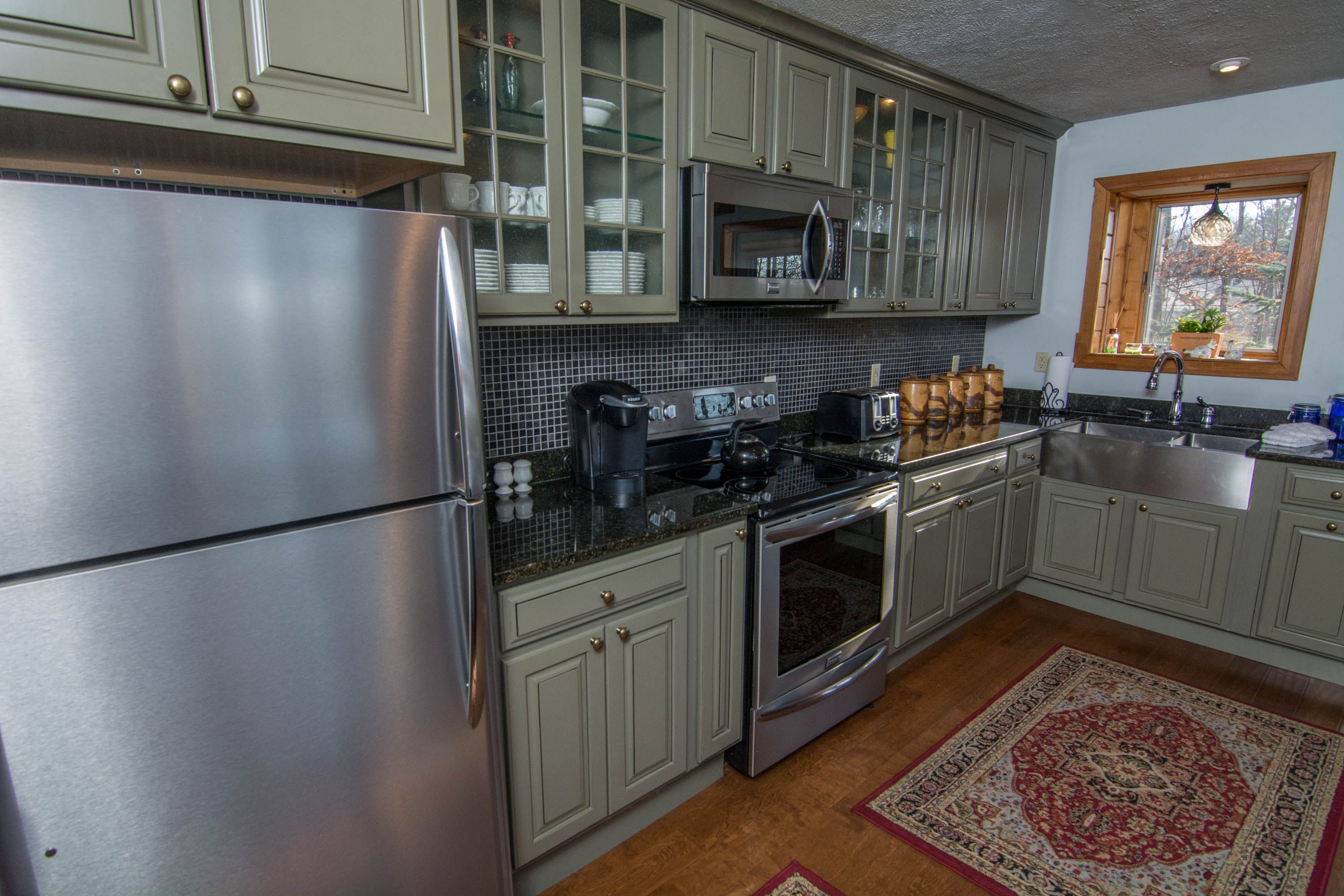 You don't often see unique cabinet colors in homes! The ...