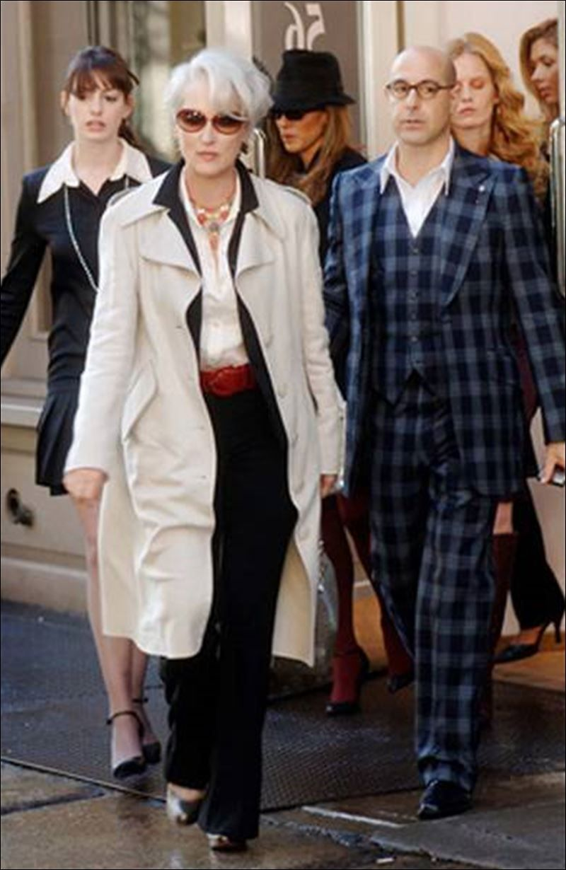 Mature Executive Style ... Miranda Priestly (Meryl Streep) with two of her assistants, Andy (Anne Hathaway), left, and Nigel (Stanley Tucci) in The Devil Wears Prada.