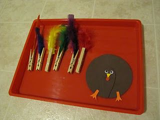 Clothespin colored turkey feathers clipped onto the turkey's tail...Cute