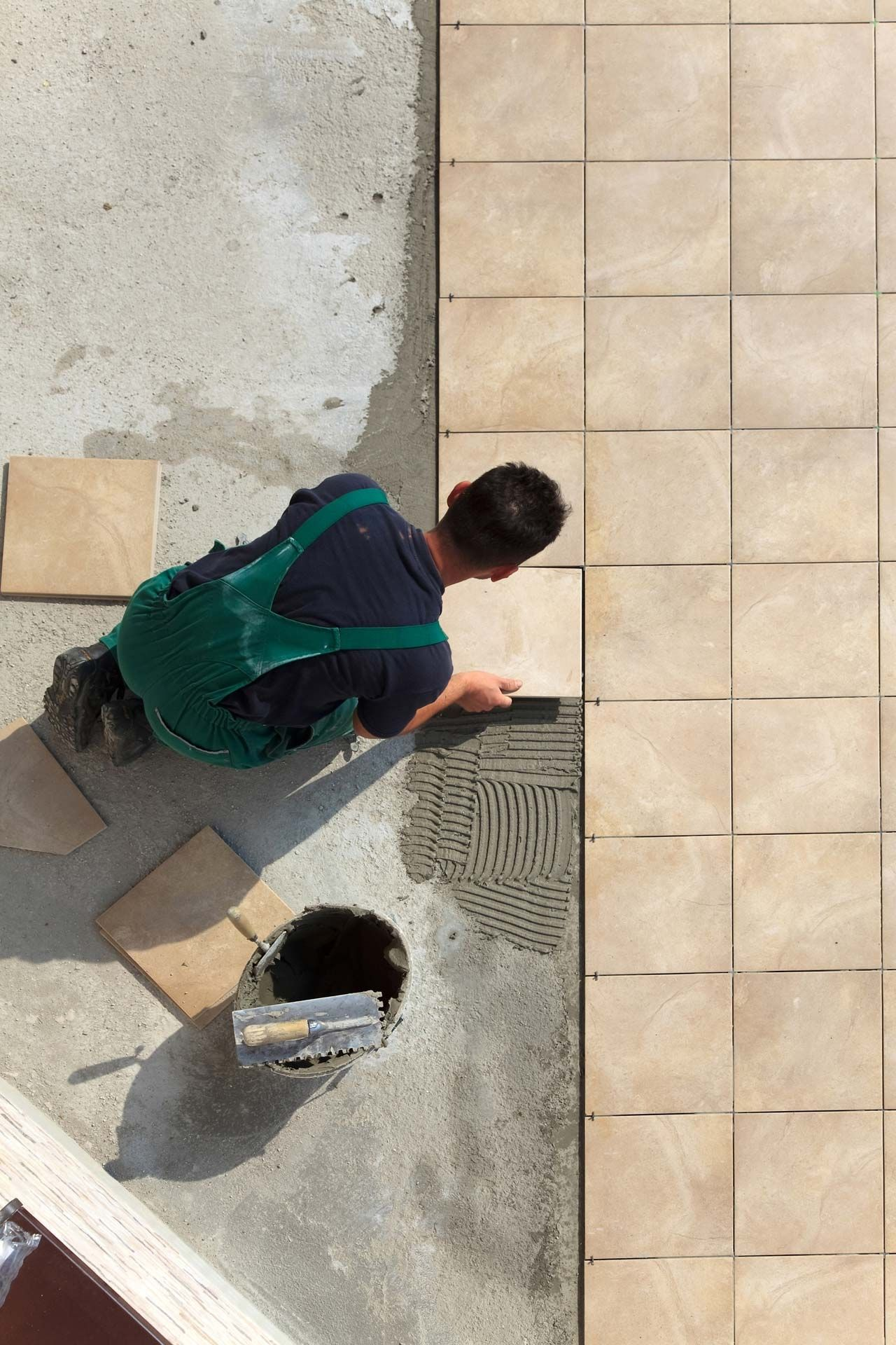 laying floor tiles on concrete slab