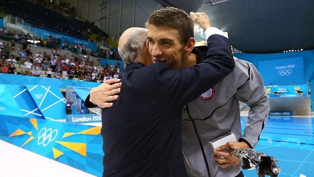 President of FINA, Dr. Julio Maglione, embraces Michael Phelps of the United States after he presented Phelps with a special award from FINA for his career achievements on Day 8 at the Aquatics Centre.