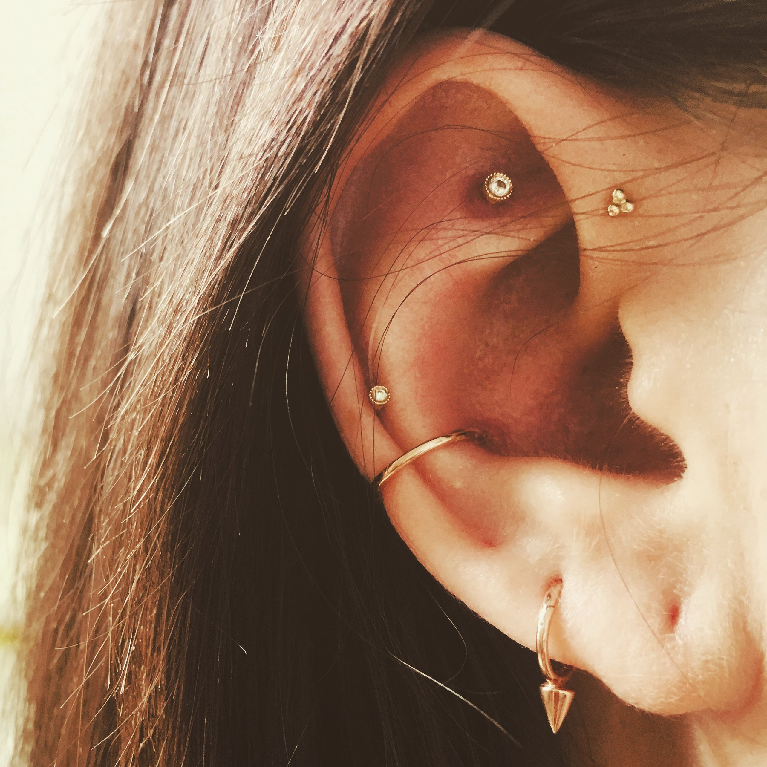 Double nose piercing  Conch forward helix and Tash Rook piercings mariatashlondon