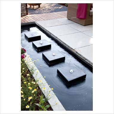 Modern rectangular pond with row of square water features for Square pond ideas