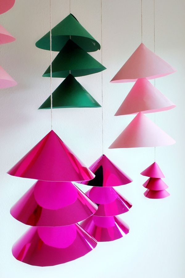 hang a holiday forest from your ceiling this winter oh happy day shares how to make diy giant christmas bells inspired by old danish bell ornaments