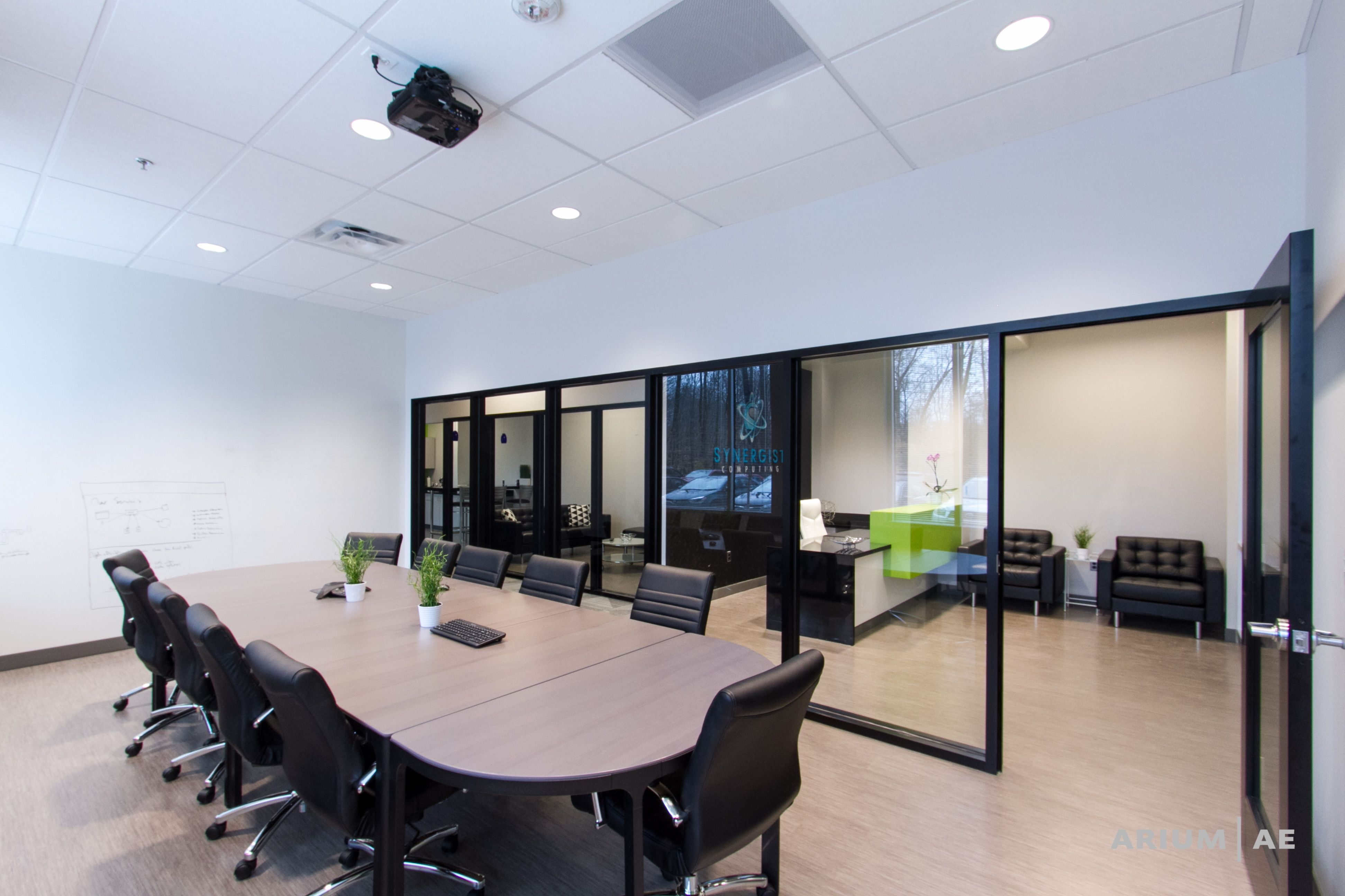 Office conference room with black framed glass wall and views to ...