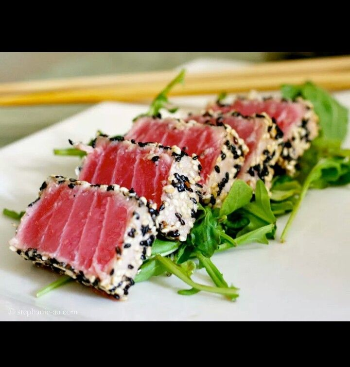 Sesame & black pepper crusted ahi tuna with arugula. I add avocado & Wasabi mayo & ponzu sauce drizzled on top. Mmmmm