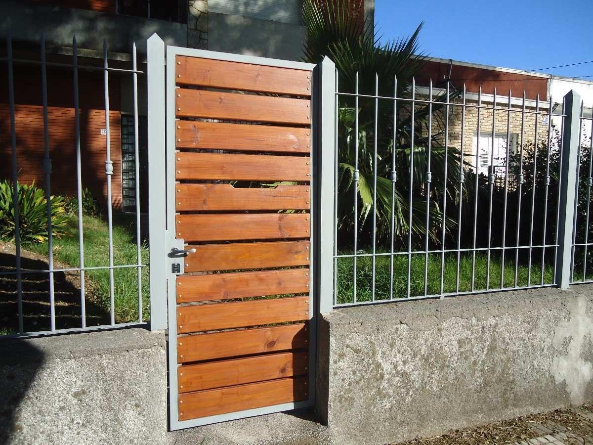 Rejas portones cerramientos perimetrales hierro y madera for Rejas de madera