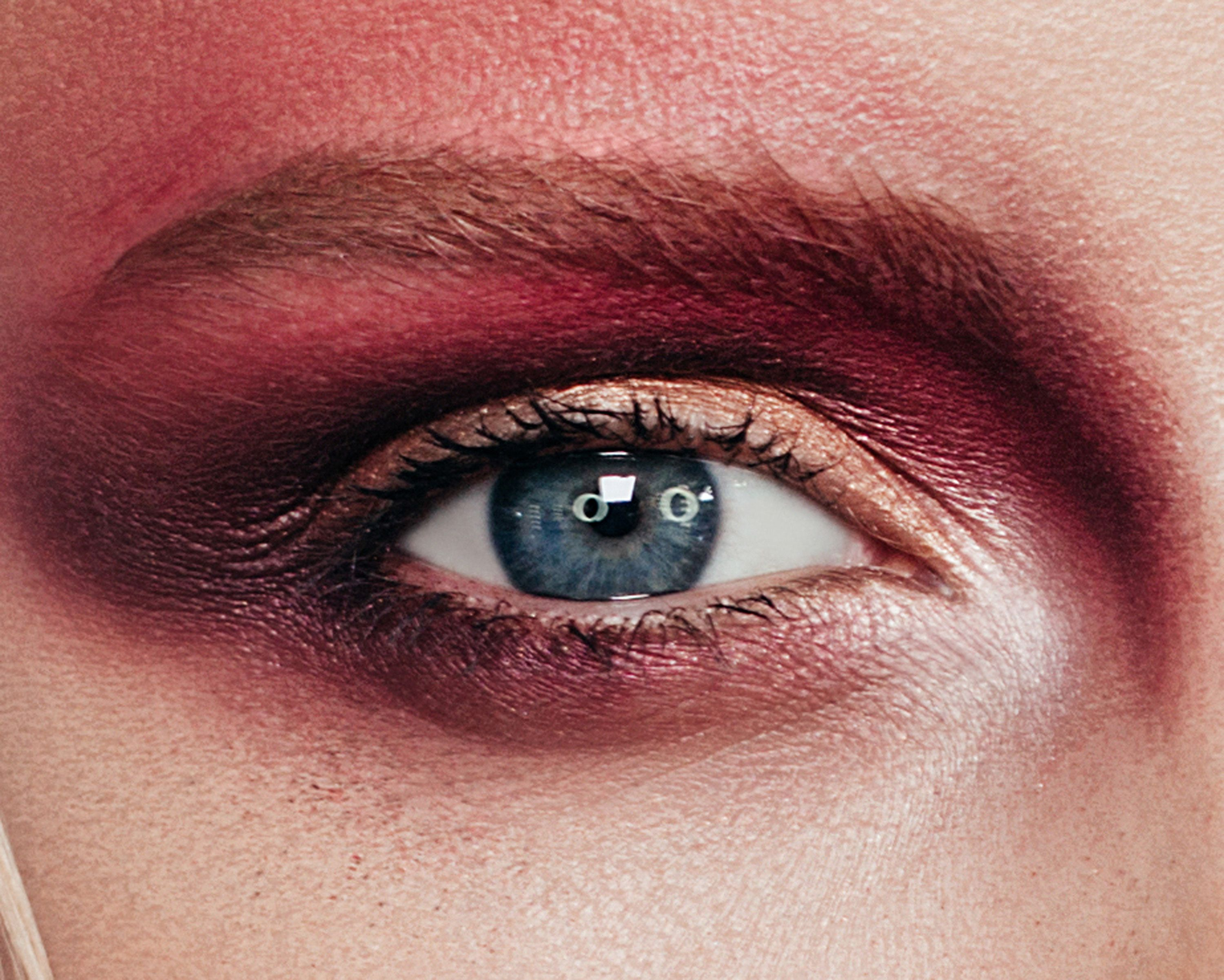 A close up of a dramatic makeup look with burgundy smokey