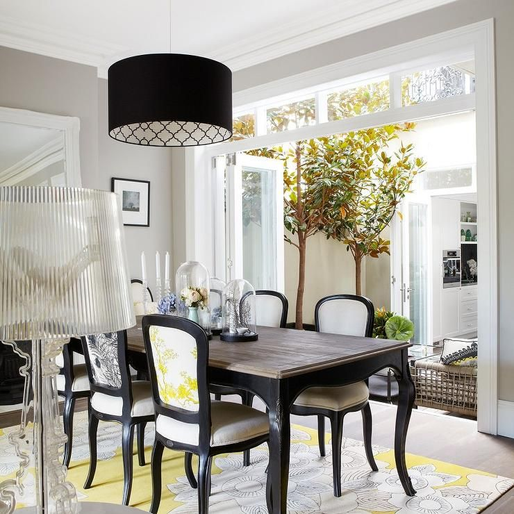 Yellow And Black Dining Room Features A Drum Pendant Illuminating French Table With Cabriolet Legs Wood Top Lined