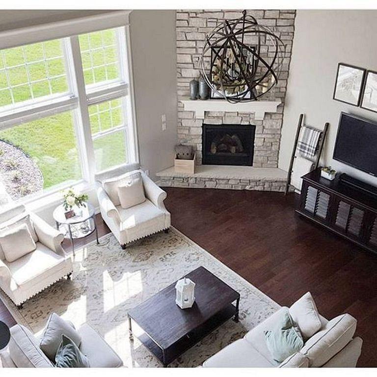 20 Elegant And Stylish Interior Design In Cape Cod Homes Corner Fireplace Living Room Living Room Corner Living Room Furniture Arrangement