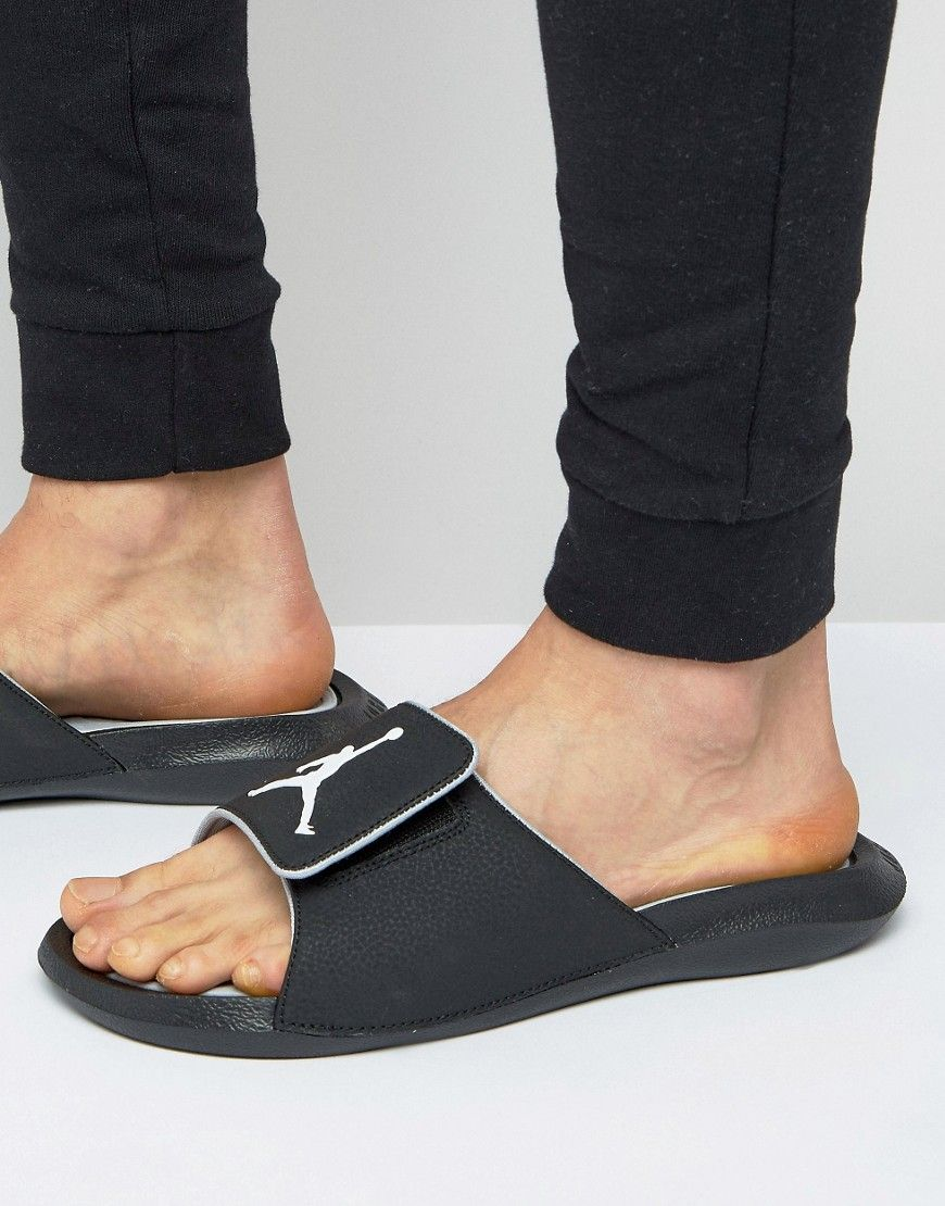 2fb7bff76bc2a2 Get this Jordan s flip flops now! Click for more details. Worldwide  shipping. Nike