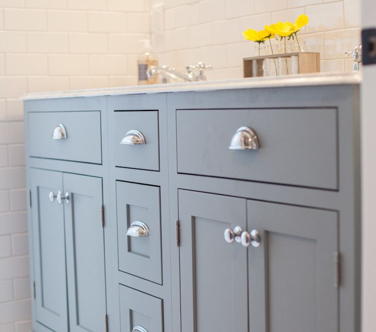 Gorgeous bathroom boasts gray dual sink vanity accented with nickel ...