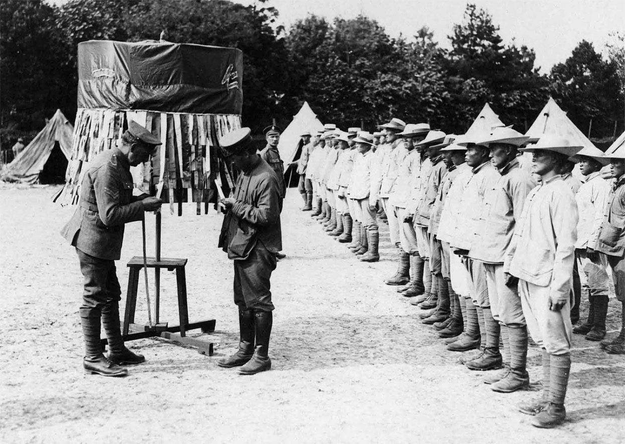Chinese labourers at a roll-call in France, during World War I. The coastal towns of China and Hong Kong, where Britain still had some influence, were the main areas from which Chinese labourers were recruited. Over 320,000 were recruited for service with the Allied Forces despite the fact that China was engrossed in her own domestic turmoil.