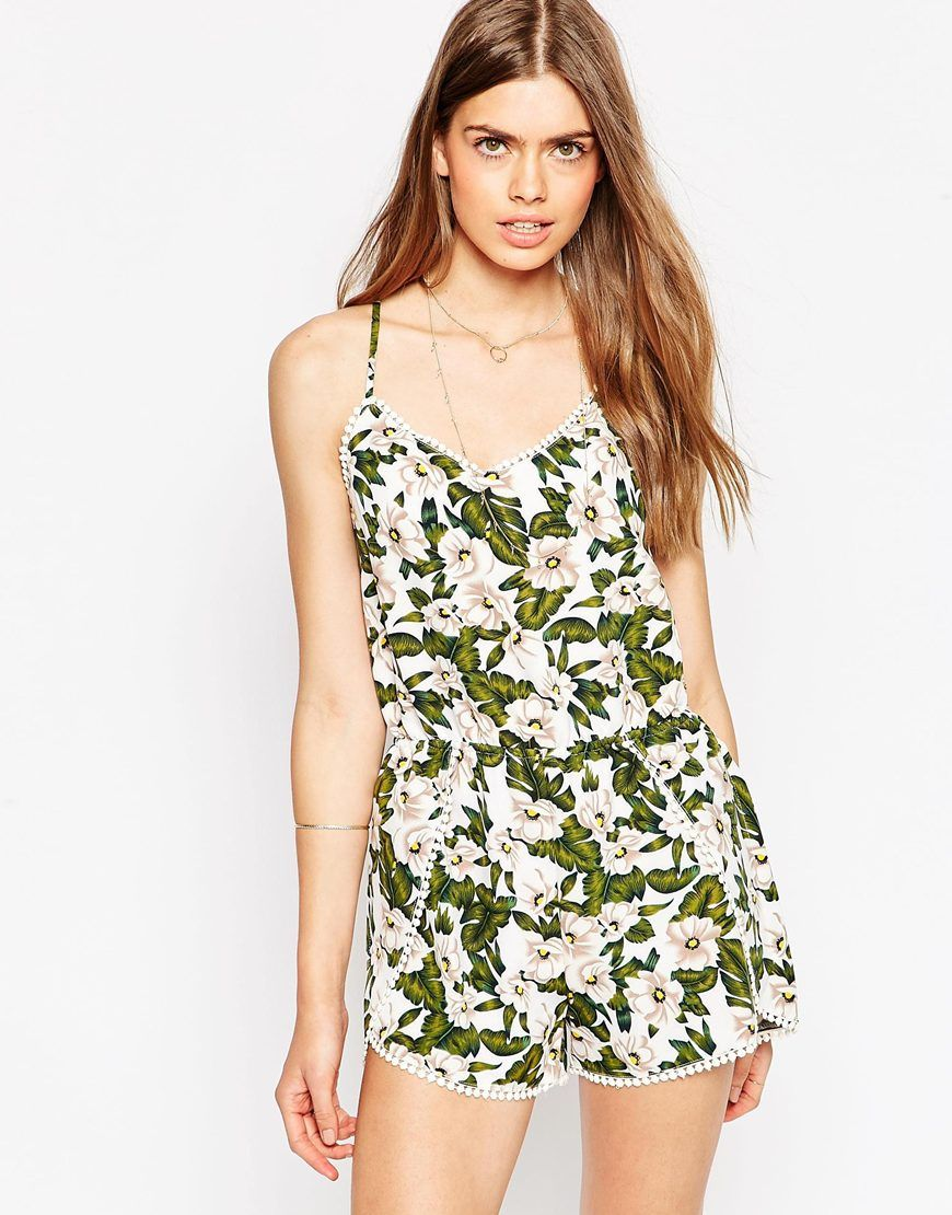 """Playsuit by Greylin Soft touch woven fabric Partially lined V-neckline Stretch waist Curved hem Pom pom trim Adjustable cross-over straps to reverse Regular fit - true to size Dry clean 100% Polyester Our model wears a UK S/ EU S/ US XS and is 176cm/5'9.5"""" tall"""