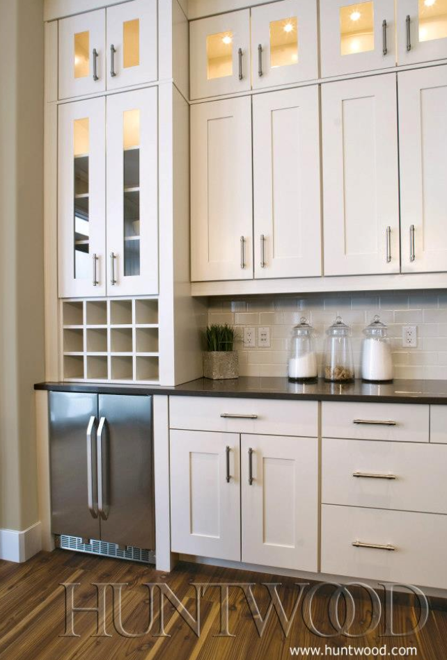 super tall cabinets with glass front doors at the tippy top