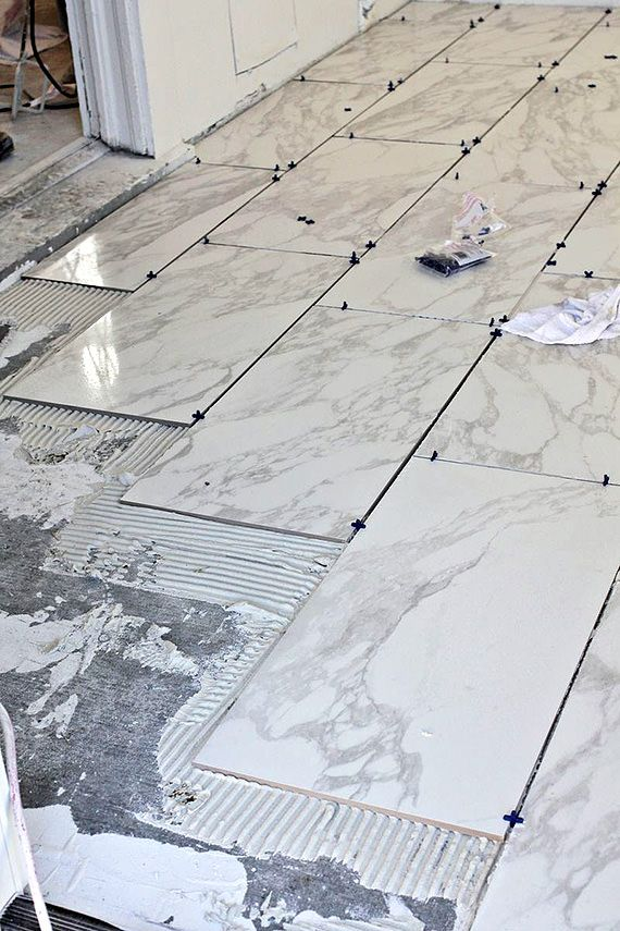 How To Tile Floors Ohmeohmy Blog Installing Tile Floor How To Lay Tile Tile Floor