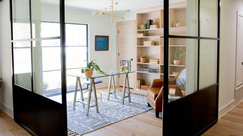 Sliding Glass Doors With Black Metal Frames Divide The Office From Rest Of House