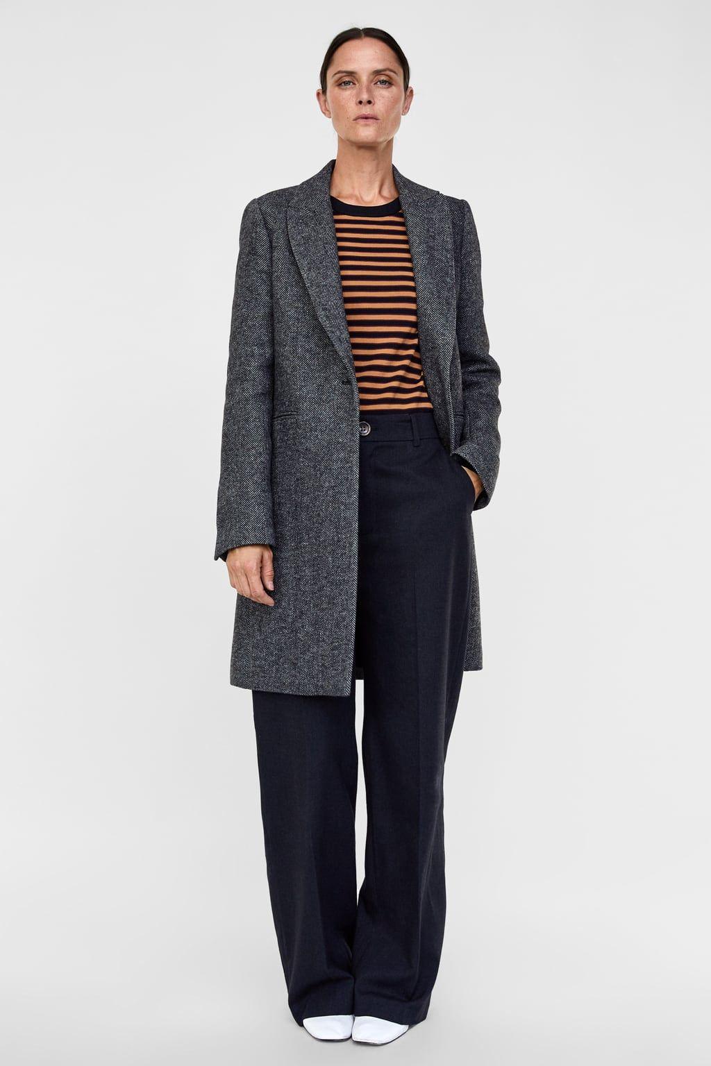 Zara schwarzer mantel fell