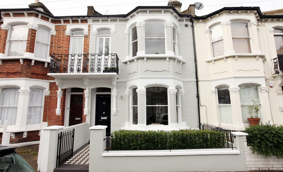 Grey painted house black front door houses pinterest for Terraced house exterior design