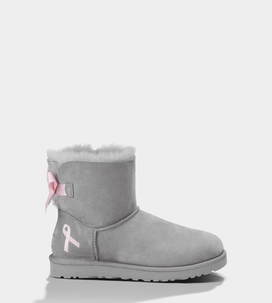 Low Top, Light Gray UGGS with a Pink Cancer accent ribbon