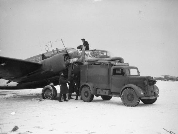 Ground staff prepare a No 233 Squadron Hudson for flight in freezing conditions at Thorney Island, 19 January 1942. The 'hot air van' has been brought in to warm up the engines and de-ice the cockpit windscreen