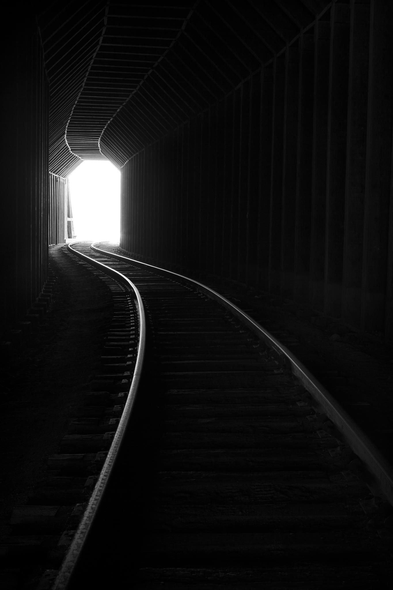 Through the train tunnel in black and white