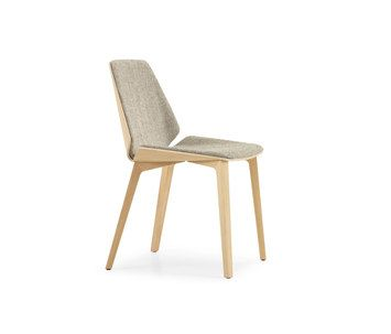 the new pala wooden shell chair by the swiss furniture manufacturer