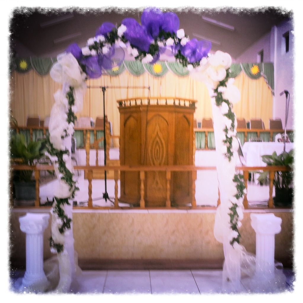 Wedding Arch decorated with Deco Mesh and Flowers