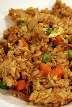 Skinny Chicken Fried Rice recipe |  4 cups rice, prepared 1/2 pound boneless, skinless chicken breasts, cooked and chopped into bite sized pieces 1 cup peas & carrots, frozen 1 small white onion, chopped 2 cloves garlic, minced 2 eggs 3 tablespoons sesame oil 1/4 cup lite soy sauce