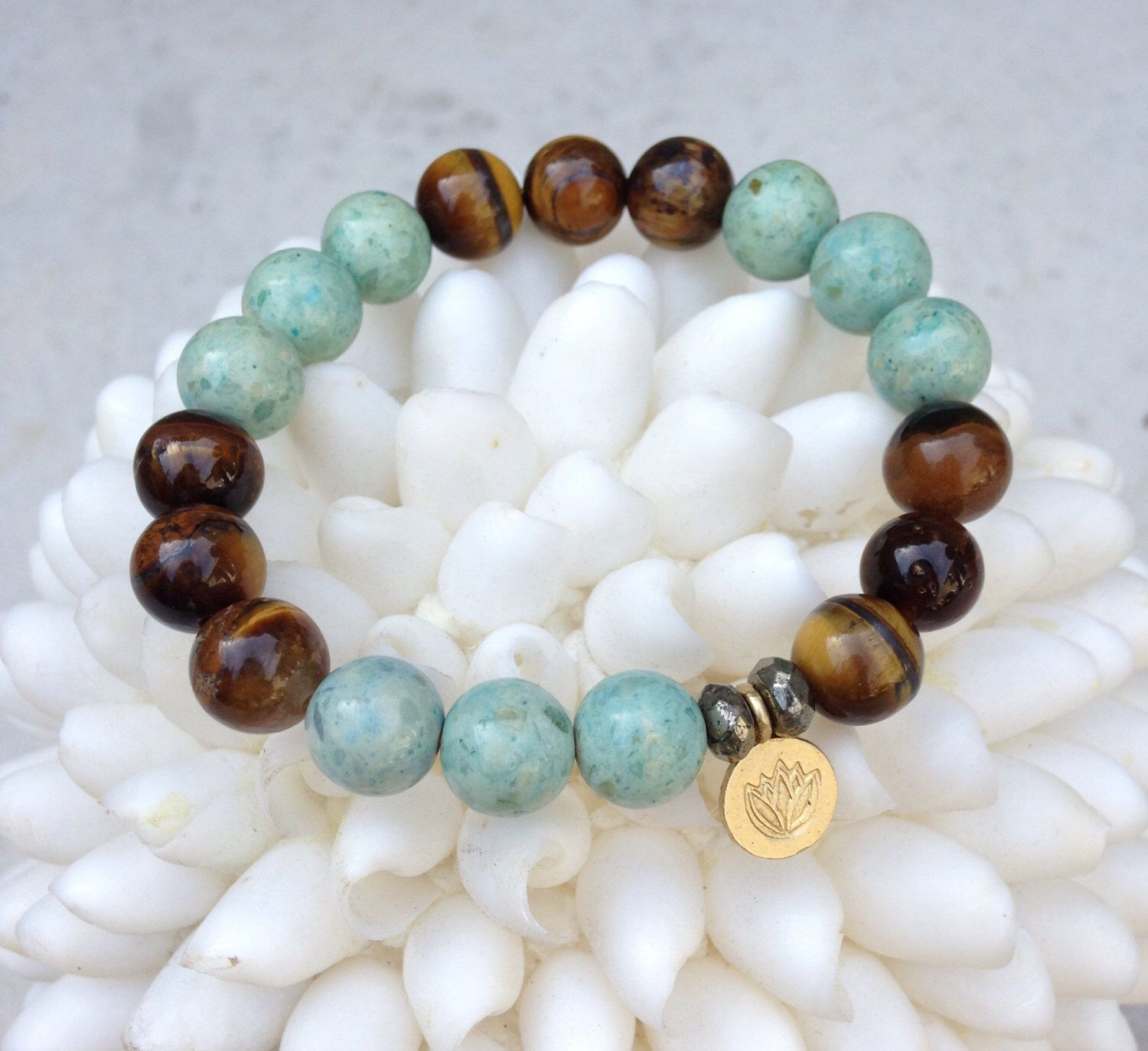 A personal favorite from my Etsy shop https://www.etsy.com/listing/231346164/power-n-truth-turquoise-tigers-eye
