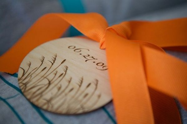 Engraved wood favor tag.  Keepsake place cards that can be used as an ornament later on.