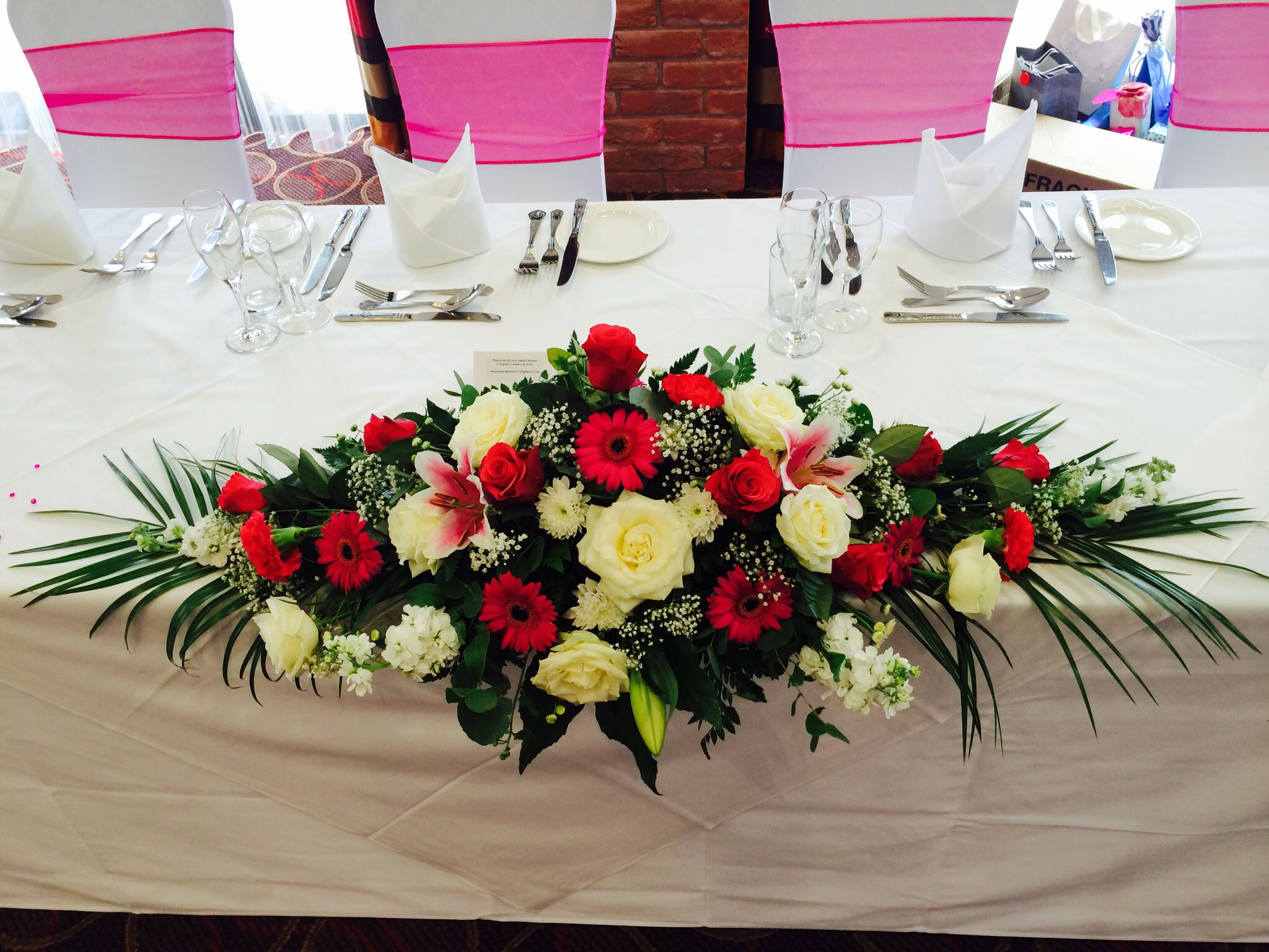 Top table arrangement in hot pinks